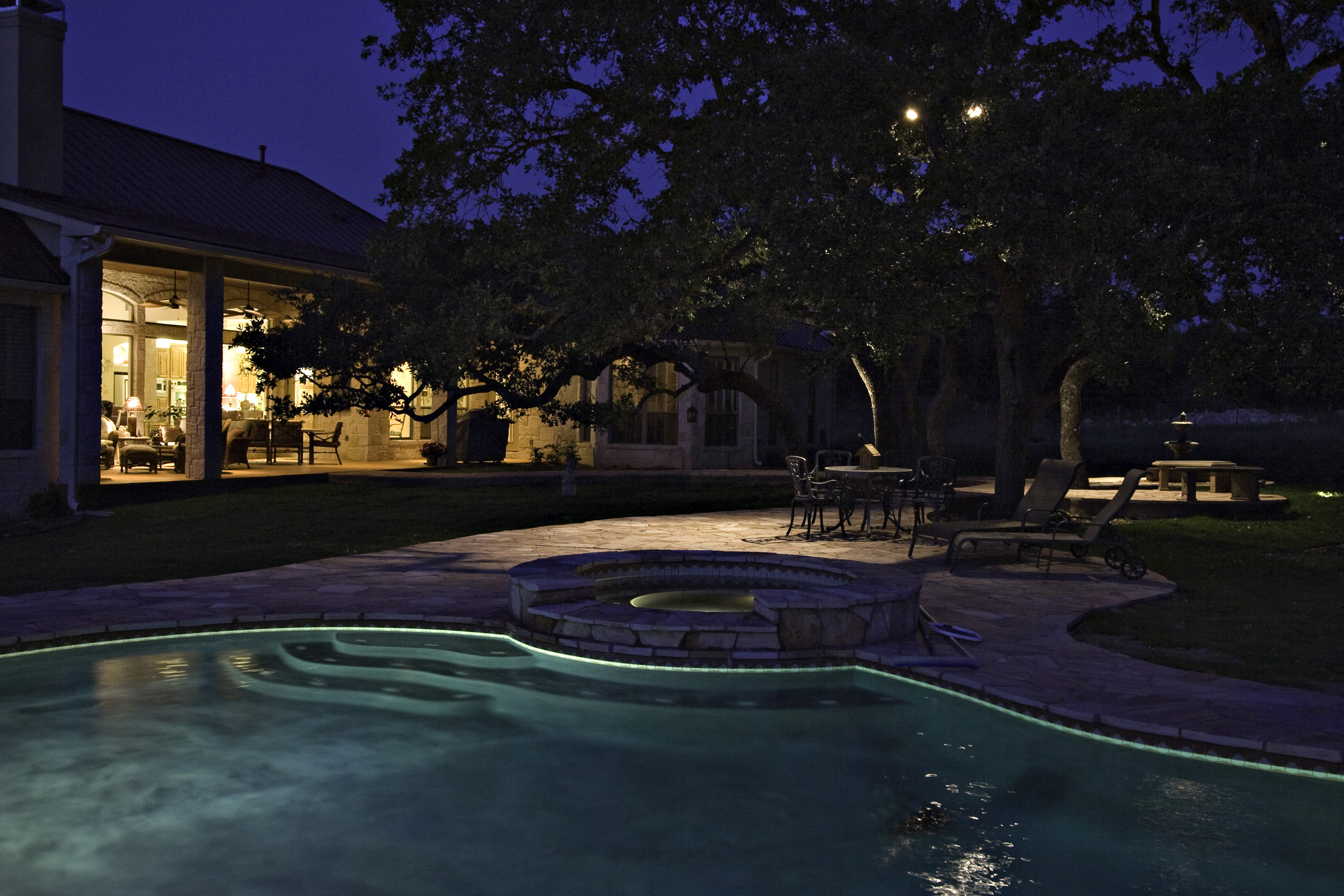 Outdoor lighting can create a romantic setting in your own backyard.